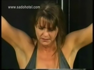 Beautiful slave with big tits and her hands tied got spanked on her ass by...