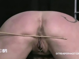 Extreme bondage video with a blonde chick who gets her arms and tits tied up...