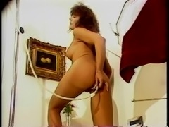 Sexy brunette with great tits cleans out her asshole solo in the bathroom