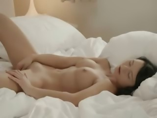 Brunette model fingering pussy in whtie