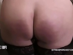 Brunette MILF bends over on a BDSM table so her husband can cane her filthy ass.