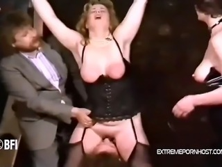Chubby blonde from Germany gets her pussy licked by a male slave and at the same time a man and a woman smite her chunky body