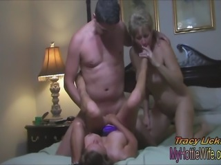 Two, big titted, hot MILFs in a sexy threesome!! He fucks us both good and dumps his load in both of our mouth's, which we snowball back and forth to each other!!