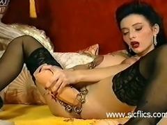 Busty brunette babe fucks a gigantic dildo