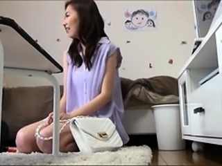 Stunning Asian babe hangs on for a deep fucking on the bed