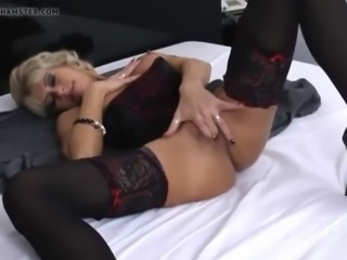 Beautiful blonde milf with heels masturbating in bed