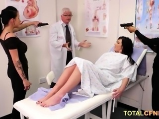 Three mischievous brunettes tugging patients cock