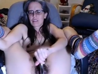 Hairy mature brunette makes herself cum hard with a sex toy