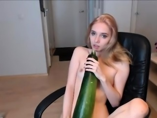 Petite babe pleases herself with a huge cucumber on webcam