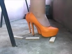 wife crush wafles under orange heels