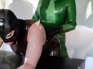 Busty latex milf toying