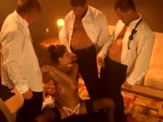 Fascinating milf with big tits enjoys a gang of hard cocks