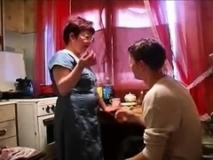 Curvy Russian mom fucked by her young lover in the kitchen