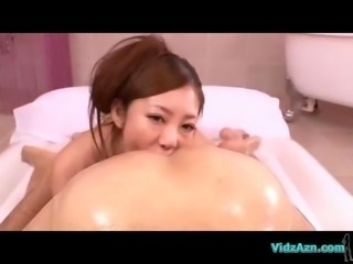 Busty Asian Girl Oil On Body Massaging Guy Sucking Him On The Airbed In The...