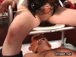 A slave gets a double dose of strapon fucking and humiliation