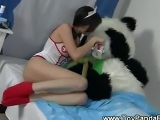 Teen playing nurse for her toypanda