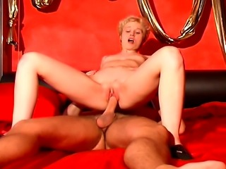 Sexy blonde whore with huge milky tits enjoys a hardcore sex on her red bed.