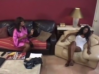 Darksome lesbian babes fucking with huge strapon