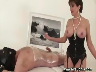 Mistress jerking off her bound slave
