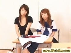 Asian schoolgirl sucks on a cock while the other students watch