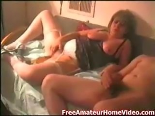 Amateur film with a mature couple having some fun in the bedroom