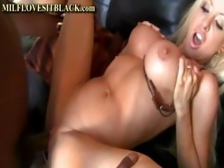 Fake-boobed blonde porn babe gets boinked by a black hunk's penis 03:03