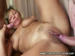 Hot grandma fucked on table by two men
