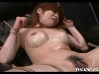 Bound hairy Asian made to orgasm with multiple sex toys