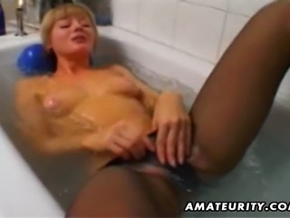 A cute blonde amateur wife toys and masturbates her shaved pussy in her...