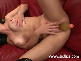 Extreme amateur whore loves to fuck her huge gaping pussy with huge champagne...