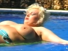 Hot MILF with juicy tits gets fucked by hard huge cock and doing reverse cowgirl fucking by the pool.