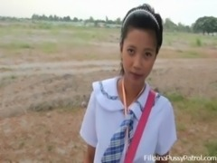Real life Asian schoolgirl outdoors free
