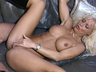 Hot blonde MILF woke up her guy with a mild blowing blow-job as she grabs his cock and sucks it vigorously before the dude probes her pussy with a vibrator. She was very wet so he then used his raging boner to demolish her pierced pussy.
