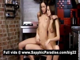 Adorable blonde and brunette lesbians kissing and getting naked in a three...