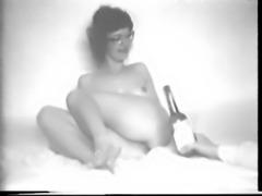 Bottle in her pussy