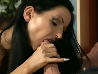 Horny Brunette MILF in latex lingerie and boots came over to surprise her lover with some hot sucking and fucking...He must admit that her loved the surprise.