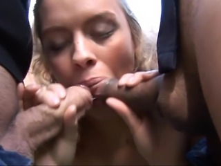 Sweet blonde blows on two cocks outside of the house. Then she bends over and takes one cock from the back while she blows another