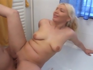Extremely attractive blonde slut gets fucked in the bathroom. Dude pounds her pussy merciless and fills her mouth with his warm cum