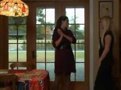 Milf in a sweater dress seduces a youn lady