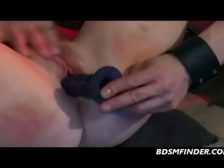 Redhead chained down spanked and made to orgasm hard