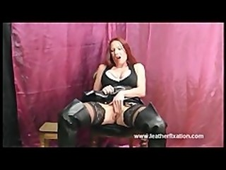 Dirty redhead put on leathers and rubs her wet pussy