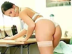 Sexy secretary masturbates in sheer stockings