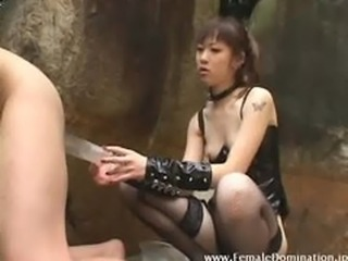 Slave experiences a painful enema from mistress
