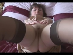Hairy granny in slip and stockings with see thru panties strips and teases .....