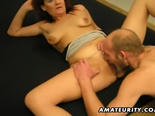 A nasty mature redhead amateur housewife homemade hardcore action with a young guy ! Blowjob and fuck with cumshot on her ass !