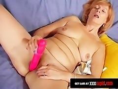 Redheaded Granny Uses a Dildo