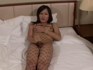 Japanese tranny in fishnet wanking