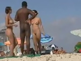 Western Tourists fawning over Malabari Negro at Goa Nude Beach
