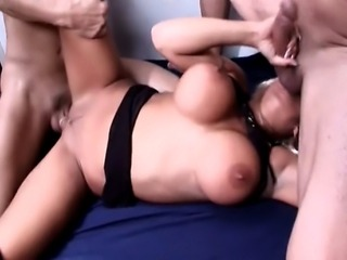 26 year old porn superstar from Canada with fake 36C tits and a 35 inch ass does anal with 2 fit guys. Her hair is dyed blonde which is rare for her.