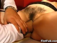Two crazy docs fist slut pussy